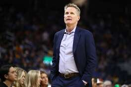 Coach Steve Kerr of the Golden State Warriors stands on the side of the court during their game against the Los Angeles Lakers at Chase Center on October 5, 2019 in San Francisco.
