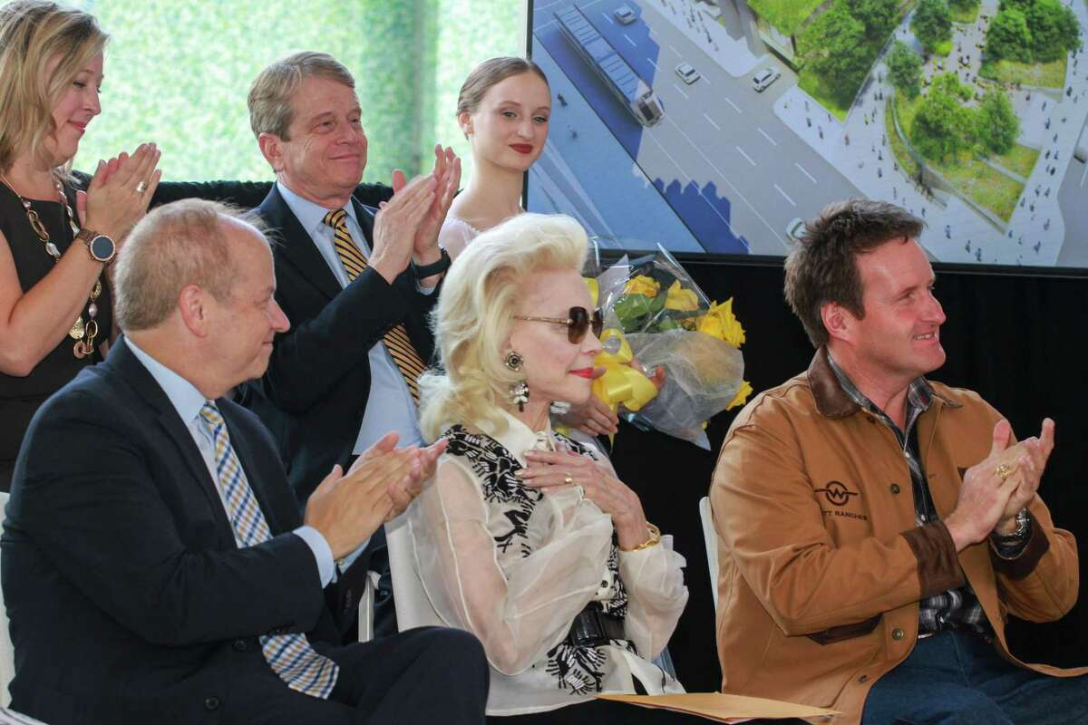 Lynn Wyatt reacting to audience applause at a press conference at Jones Plaza on October 7, 2019. She has committed a $10 million gift to ensure that a transformation of the former Jones Plaza downtown can be undertaken. The new square will be named the Lynn Wyatt Square For the Performing Arts. On the right is her son, Bradford Wyatt.
