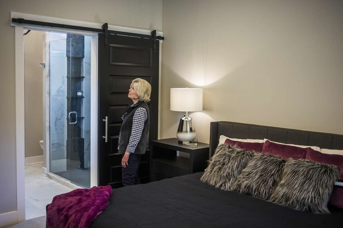 Marsha Gottesman of Midland checks out the master bedroom while touring a new home by Cobblestone Homes, at 4116 Pebble Creek Drive, during the 2019 Fall Parade of Homes hosted by The Home Builders Association of Midland Saturday, Oct. 5, 2019. (Katy Kildee/kkildee@mdn.net)