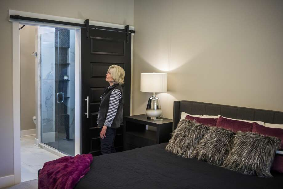 Marsha Gottesman of Midland checks out the master bedroom while touring a new home by Cobblestone Homes, at 4116 Pebble Creek Drive, during the 2019 Fall Parade of Homes hosted by The Home Builders Association of Midland Saturday, Oct. 5, 2019. (Katy Kildee/kkildee@mdn.net) Photo: (Katy Kildee/kkildee@mdn.net)