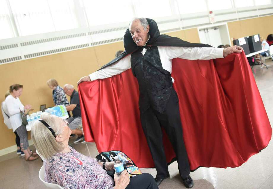Blood drive organizer Gary Silberberg dresses as Dracula during the Temple Sholom American Red Cross Blood Drive at Christ Church in Greenwich, Conn. Monday, Oct. 7, 2019. This month's blood drive was sponsored by Sophia's costume rentals, providing event organizer Gary Silberberg's Dracula costume. Photo: Tyler Sizemore / Hearst Connecticut Media / Greenwich Time