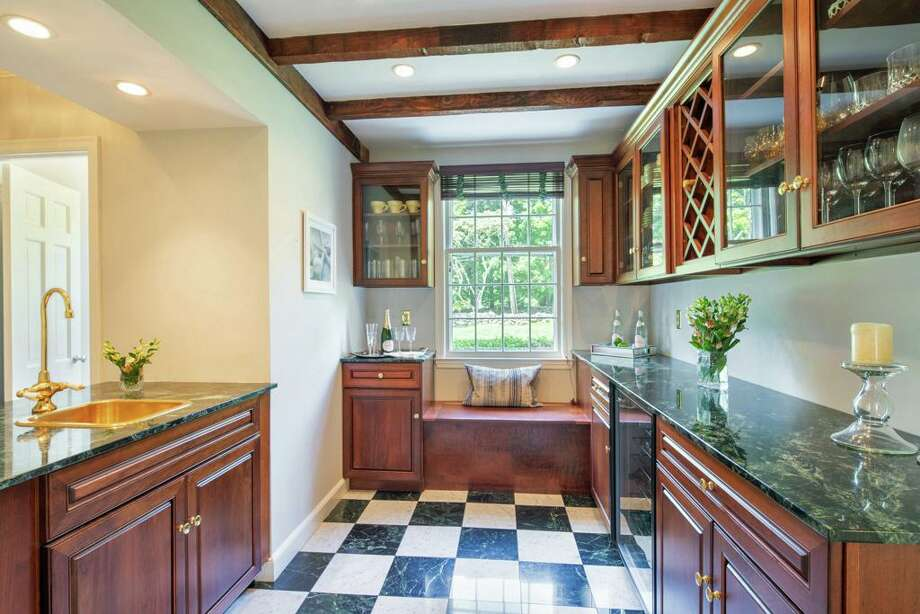 Entertaining is augmented by the large butler's pantry/wet bar. Photo: Austin Eterno / Austin Eterno 2019