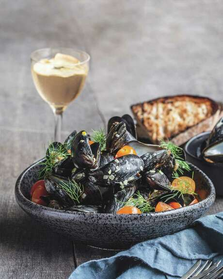 """Mussels in Shallot-Saffron Broth from """"Houston Cooks"""" by Francine Spiering."""