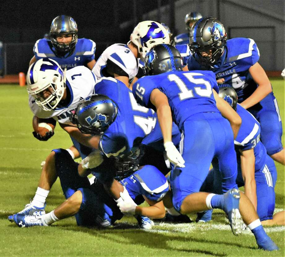 Andrew Valdez (45) and the Needville defense stop a Yoakum ball carrier as Cole Todd (15) closes in during their Sept. 20 game at Blue Jay Stadium. Photo: Needville ISD Communications / Needville ISD Communications