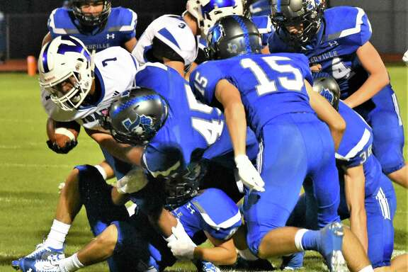 Andrew Valdez (45) and the Needville defense stop a Yoakum ball carrier as Cole Todd (15)closes in during their Sept. 20 game at Blue Jay Stadium.