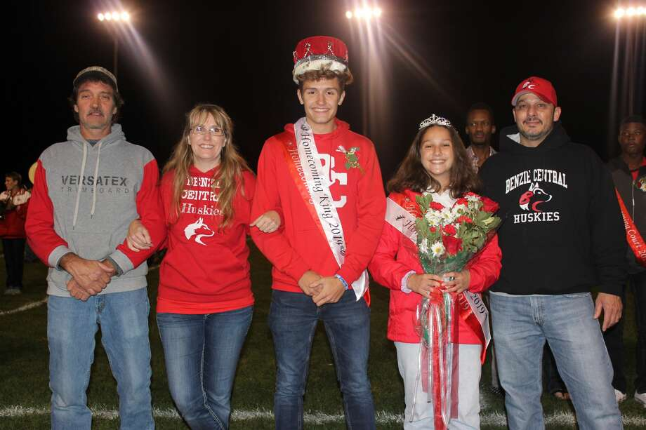 2019 homecoming king Ryan Bishop and queen Novia Dalzell are honored with their parents during halftime of Benzie Central's Oct. 4 football game against Kingsley. Photo: Robert Myers