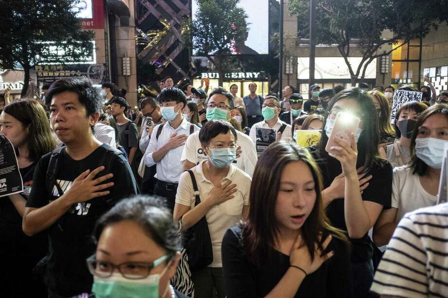 Demonstrators  protest in the Causeway Bay district of Hong Kong last week. A reader wonders why the U.S. has not yet intervened or shown support. Photo: Chan Long Hei /Bloomberg / © 2019 Bloomberg Finance LP