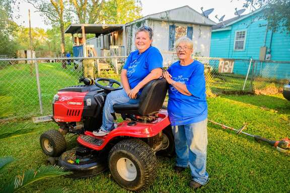 Sherry Johnson, right, Jo Keller and two other women started the San Leon Yard Birds, a group that mows yards for free in her community for those who need help such as the disabled, the elderly and others who are homebound.