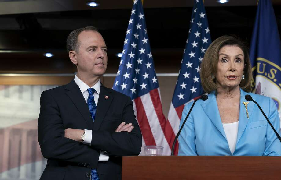 House Speaker Nancy Pelosi is joined by Intelligence Committee Chairman Adam Schiff at a news conference Oct. 2 on Capitol Hill. Photo: J. Scott Applewhite / Associated Press