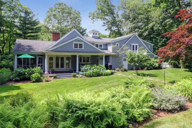 The one-acre property features an in-ground swimming pool, professional landscaping and attractive perennial gardens.