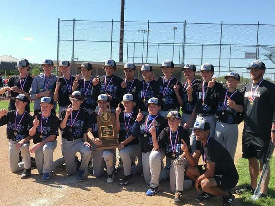 The Liberty Middle School baseball team celebrates with the IESA Class 3A state championship trophy. Photo: For The Intelligencer
