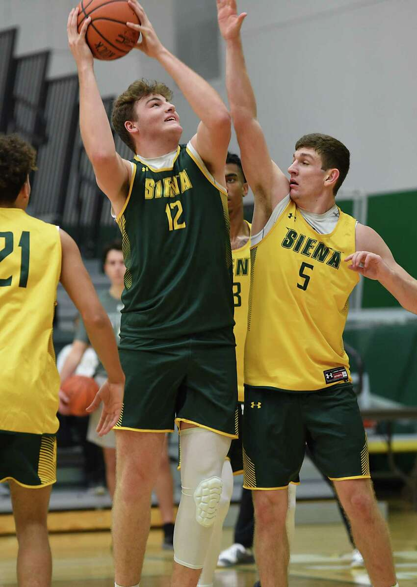 Kyle Young, #12, goes up for a shot against Matt Hein, #5, as Siena men's basketball holds an open practice for fans at the Alumni Recreation Center at Siena College on Monday, Oct. 7, 2019 in Loudonville, N.Y. (Lori Van Buren/Times Union)