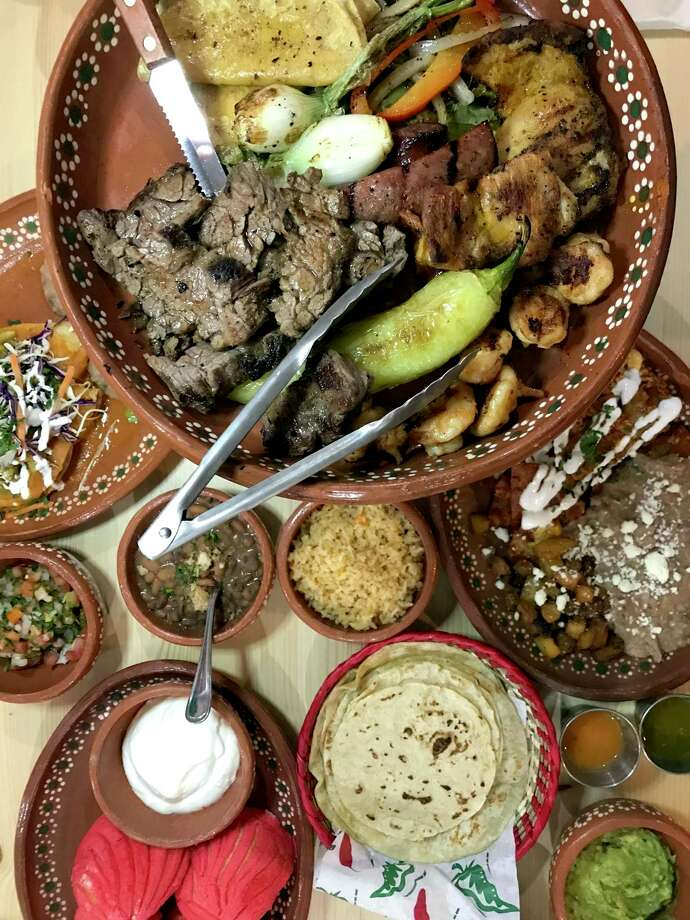 A selection of menu items including the parrillada al carbon from Tlahco Mexican Kitchen Photo: Paul Stephen / Staff