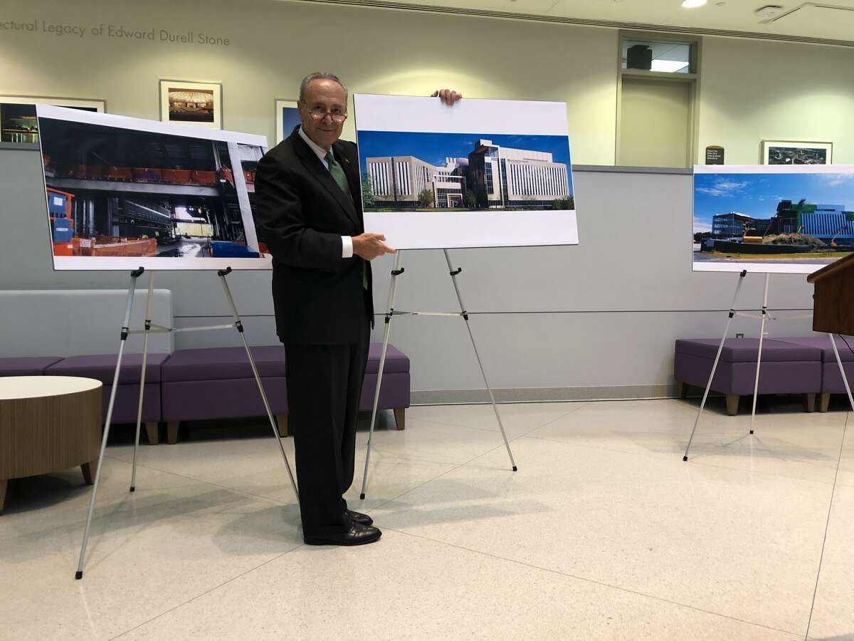 Senate Minority Leader Charles E. Schumer holds up a picture of what will be the University at Albany's Emerging Technology and Entrepreneurship Complex at a press conference on Monday, Oct. 7, 2019.