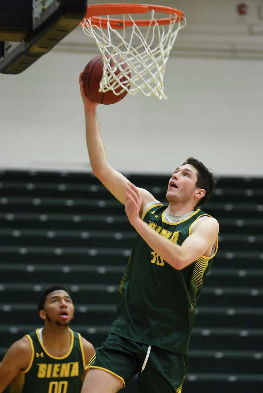 Luke Sutherland goes up for a shot as Siena men's basketball holds an open practice for fans at the Alumni Recreation Center at Siena College on Monday, Oct. 7, 2019 in Loudonville, N.Y. (Lori Van Buren/Times Union)