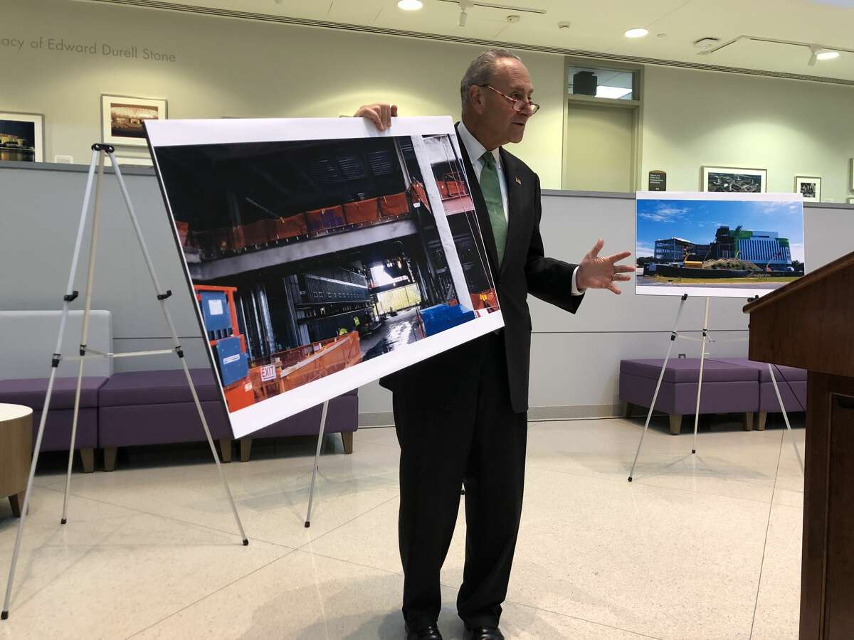 Senate Minority Leader Charles E. Schumer holds up a picture showing the construction site of the University at Albany's Emerging Technology and Entrepreneurship Complex at a press conference on Monday, Oct. 7, 2019.