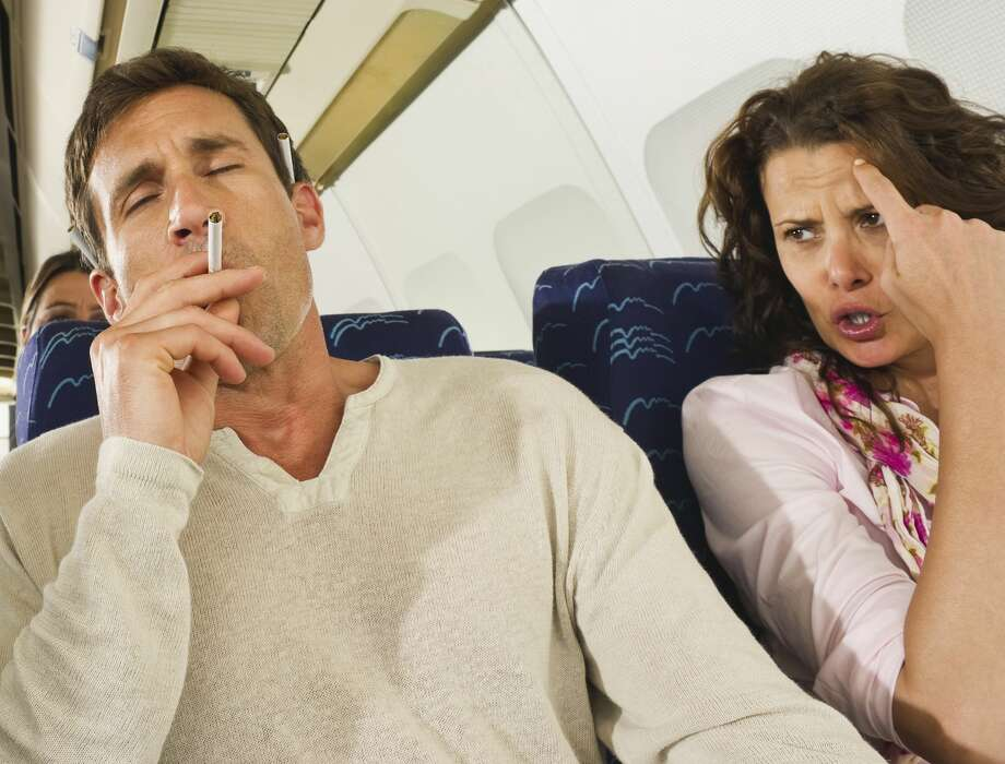 Smoking on board may not get you banned, but assaulting a flight attendant sure will. Disputing credit card charges may do the trick, too. Photo: Westend61/Getty Images/Westend61