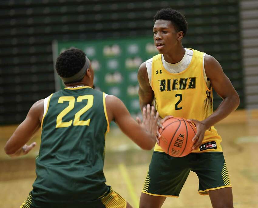 Gary Harris, Jr., #2, is defended by Jalen Pickett as Siena men's basketball holds an open practice for fans at the Alumni Recreation Center at Siena College on Monday, Oct. 7, 2019 in Loudonville, N.Y. (Lori Van Buren/Times Union)
