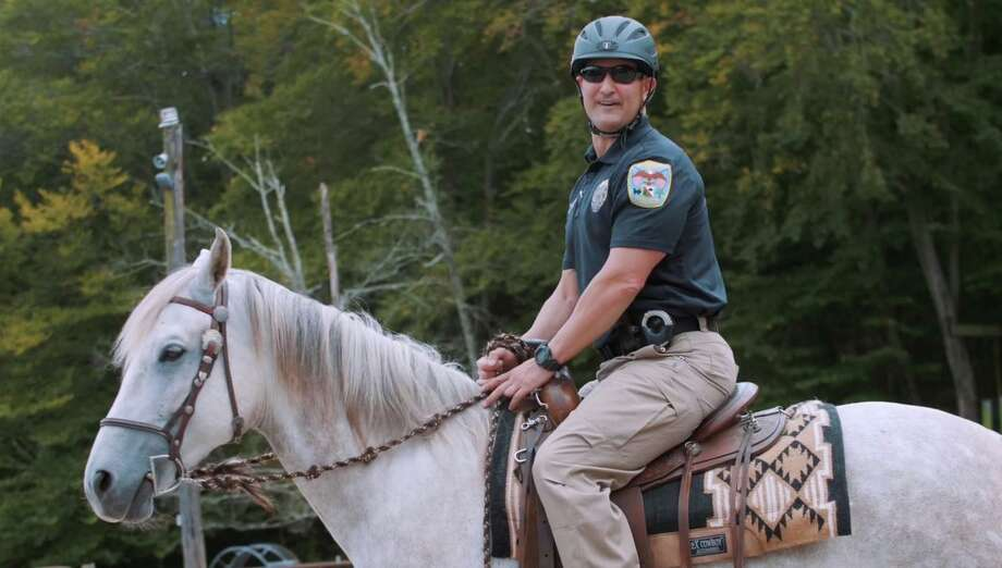 Danbury Police Lt. Vincent Daniello rides a horse in the new 2019 recruitment video for the department. Photo: Contributed Photo/Screenshot From Danbury Police Department Recruitment Video / Contributed / The News-Times Contributed