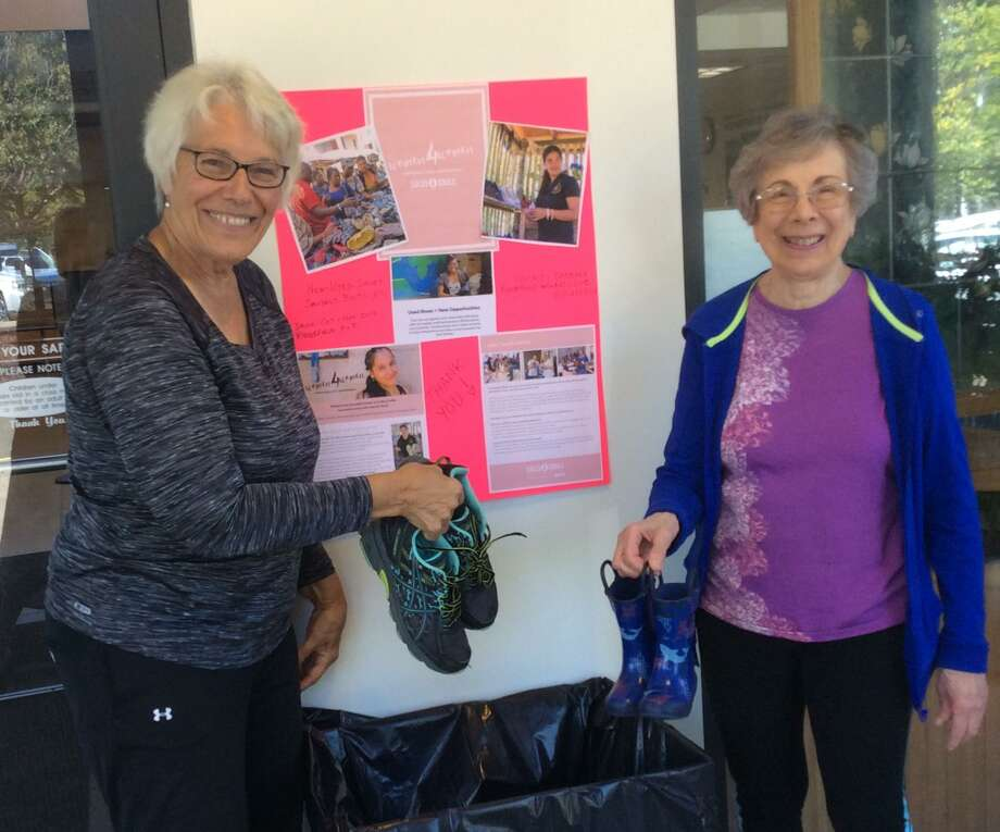 Barbara Carvalho and Susan Van Blarcom start the collection process at the Ridgefield Recreation Center. Photo: Contributed Photo