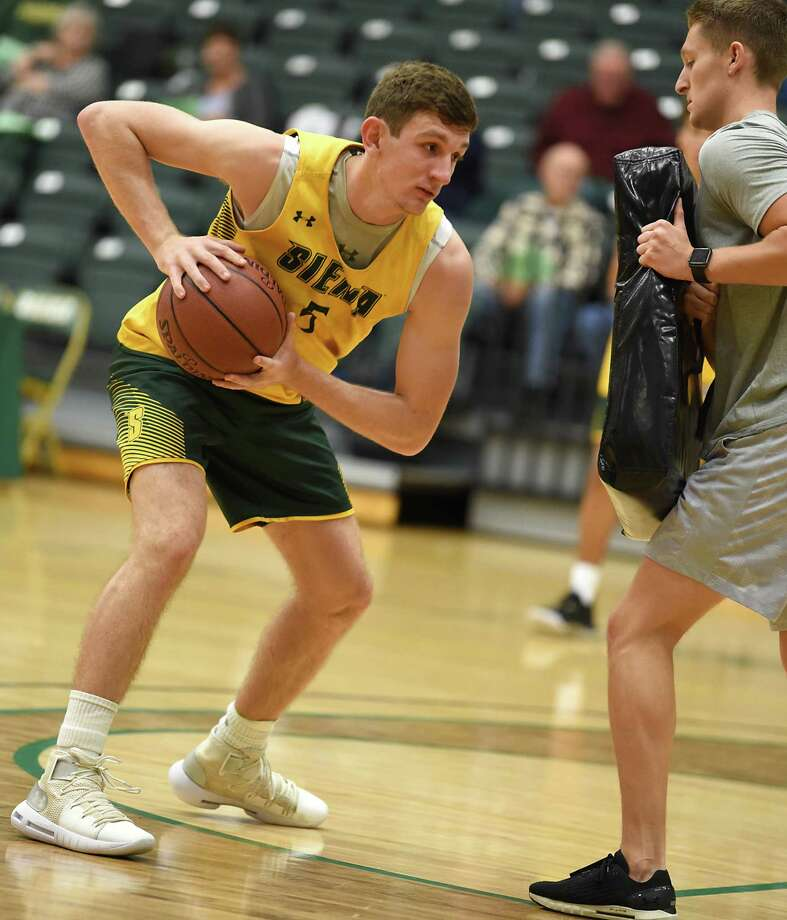 Matt Hein, left, handles the ball during a drill as Siena men's basketball holds an open practice for fans at the Alumni Recreation Center at Siena College on Monday, Oct. 7, 2019 in Loudonville, N.Y. (Lori Van Buren/Times Union) Photo: Lori Van Buren, Albany Times Union / 40047960A
