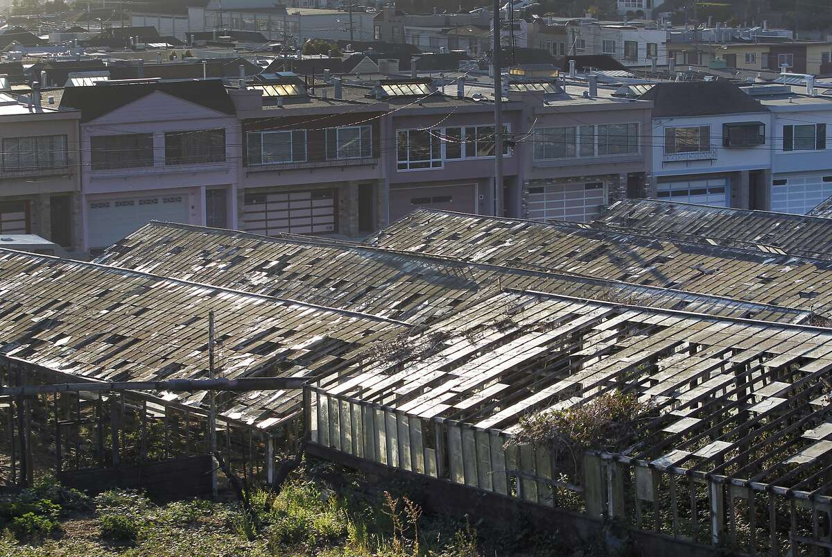 Decaying greenhouses are seen in the Portola district of San Francisco in 2015.