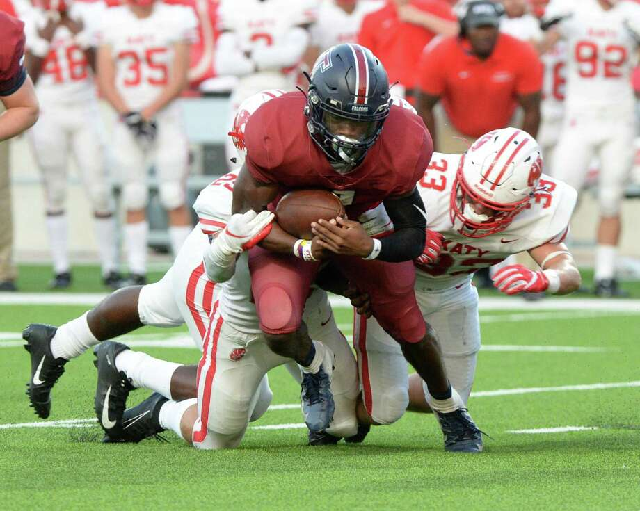 Jalen Milroe (4) of Tompkins is sacked by Shepherd Bowling (25) of Katy during the second quarter of a 6A Region III District 19 football game between the Katy Tigers and the Tompkins Falcons on Thursday, October 3, 2019 at Legacy Stadium, Katy, TX. Photo: Craig Moseley, Houston Chronicle / Staff Photographer / ©2019 Houston Chronicle