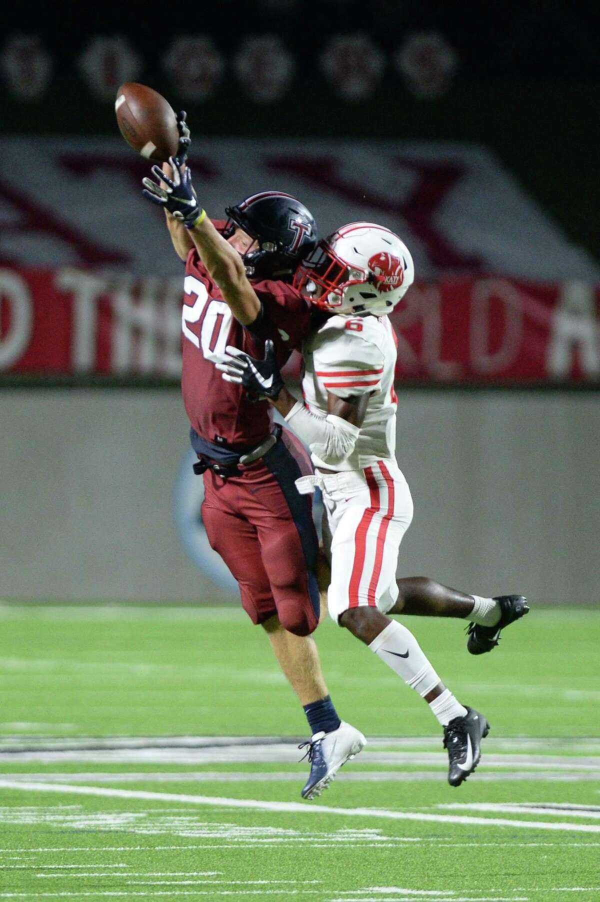 Bryan Massey (6) of Katy breaks up a pass intended for Garrett Mack (20) of Tompkins during the fourth quarter of a 6A Region III District 19 football game between the Katy Tigers and the Tompkins Falcons on Thursday, October 3, 2019 at Legacy Stadium, Katy, TX.