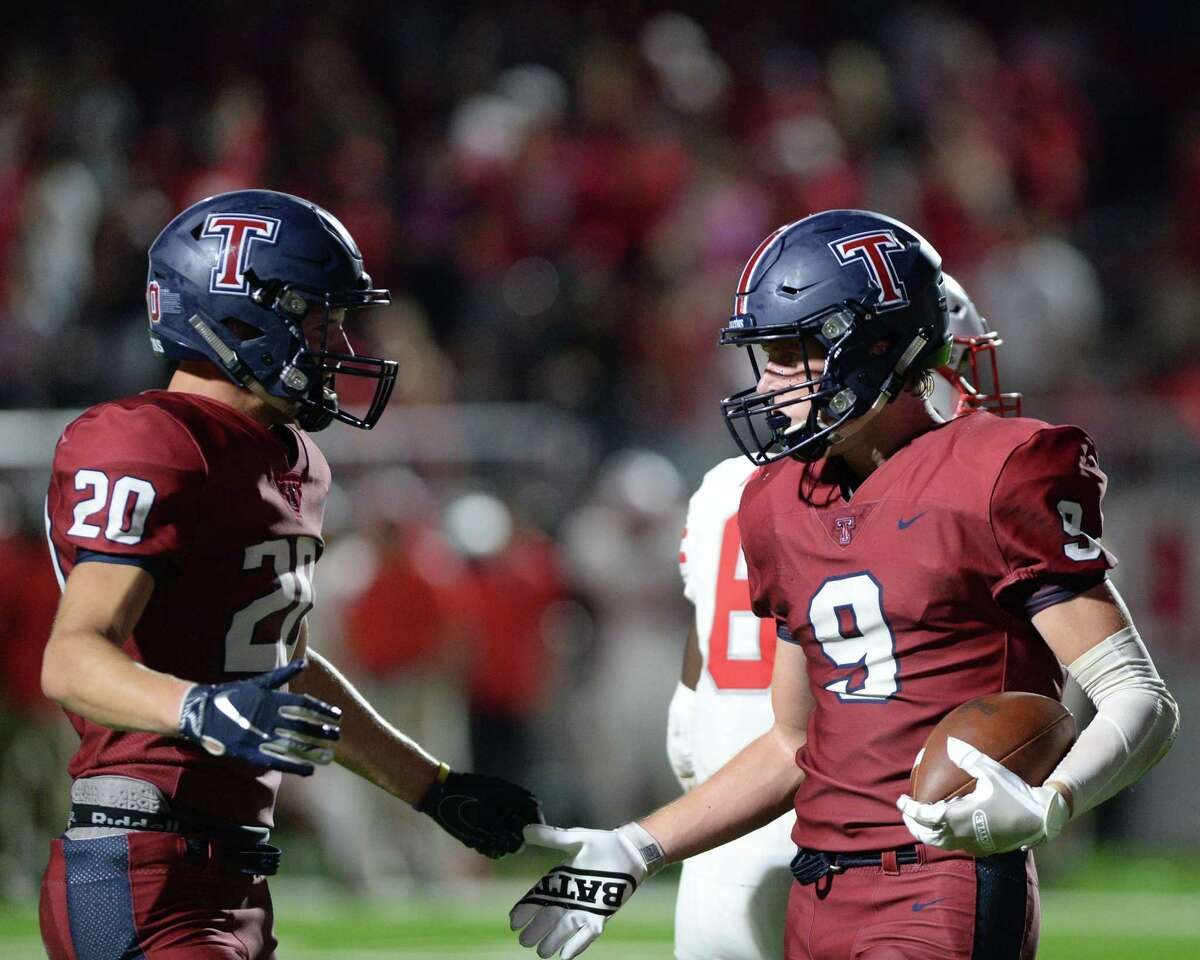 Gabe Atkin (9) and Garrett Mack (20) of Tompkins react after a touchdown reception during the fourth quarter of a 6A Region III District 19 football game between the Katy Tigers and the Tompkins Falcons on Thursday, October 3, 2019 at Legacy Stadium, Katy, TX.