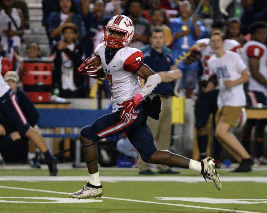 Ka'Veon Griffin (7) of Lamar makes a touchdown reception during the third quarter of a 6A Region III District 18 football game between the Lamar Texans and the Westside Wolves on Friday, October 4, 2019 at Delmar Stadium, Houston, TX. Photo: Craig Moseley, Houston Chronicle / Staff Photographer / ©2019 Houston Chronicle