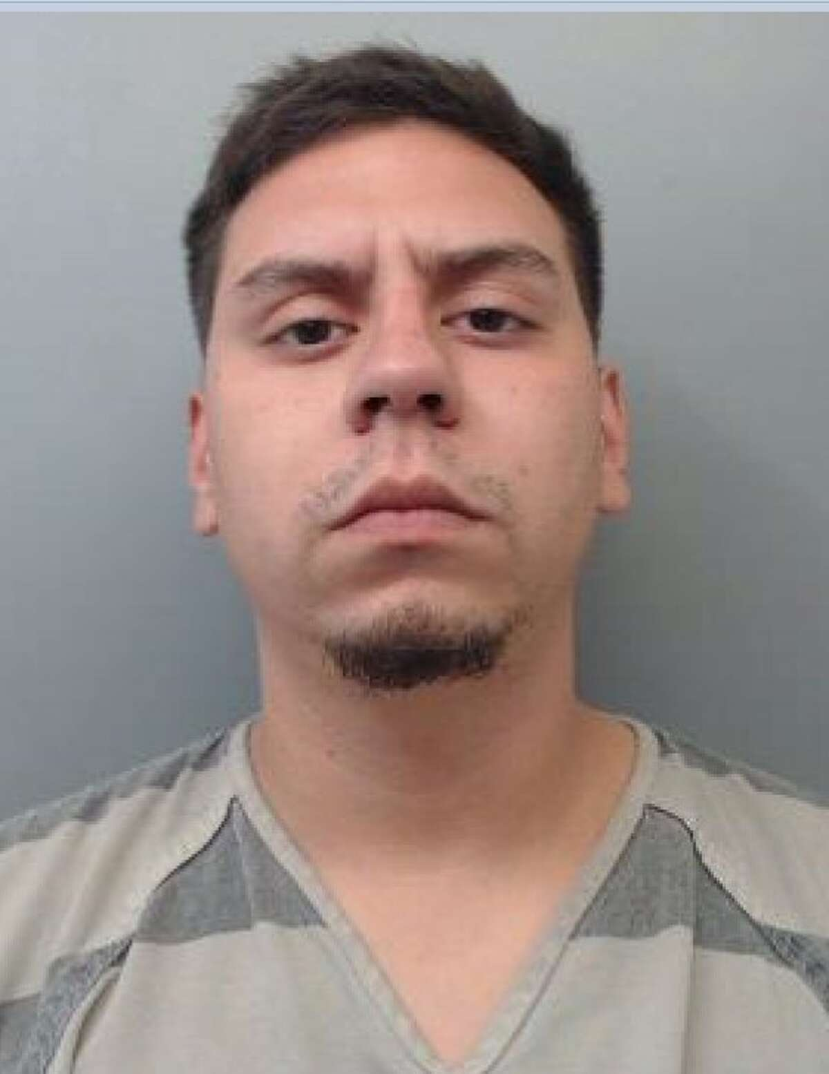 Manuel Ochoa Jr., 23, was served with an arrest warrant that charged him with aggravated assault with a deadly weapon and burglary of a habitation with intent to commit other felony.