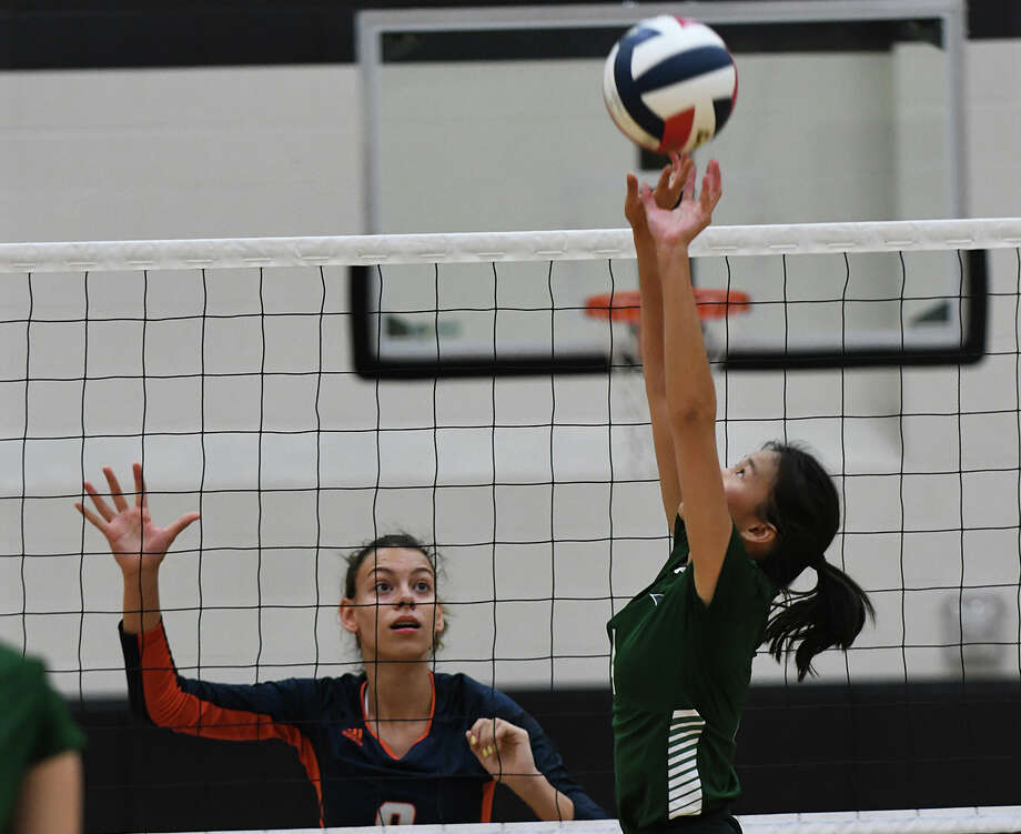 Bridgeland senior middle blocker Aidan Conner (9) works at the net against Cy Ridge senior setter Catherine Pham, right, during their pool play matchup in the 2019 Katy/Cy-Fair Volleyball Classic at Cy Parks High School on August 8, 2019. Photo: Jerry Baker/Contributor