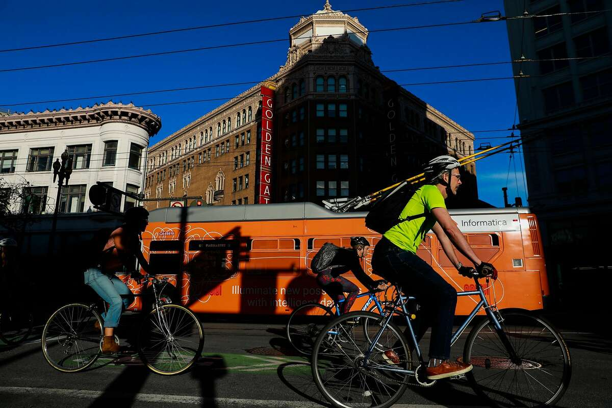 Commuters ride their bikes down Market Street in San Francisco, California, on Monday, Oct. 7, 2019.