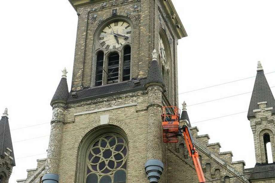 A local masonworks on a restoration project at Manistee's historic Guardian Angels Church. (Ashlyn Korienek/News Advocate)