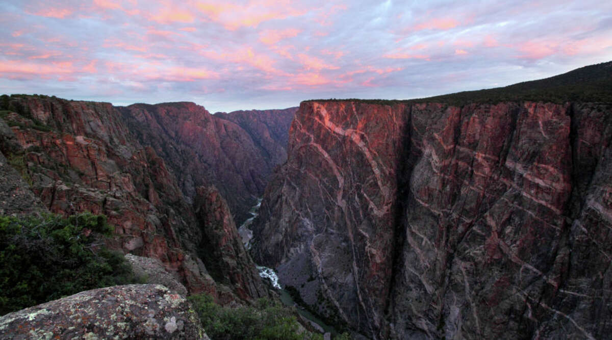 Under-the-Radar Alternative: Black Canyon of the Gunnison National Park, CO On the opposite end of the spectrum, Black Canyon of the Gunnison may just be the country's most underrated national park. With about 300,000 visitors a year and more than 15,000 acres, the park is rarely buzzing. And honestly, that makes it all the better to explore its 2,000-foot-deep canyons, 12-mile river, and dozens of butterfly-inducing overlooks. The best way to see the park is on a float down the river or on a Colorado car-camping road trip.
