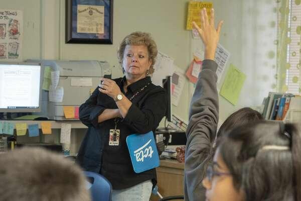 Goddard 7th grade teacher Melanie Jones works with her ELA students 10/07/19. Tim Fischer/Reporter-Telegram