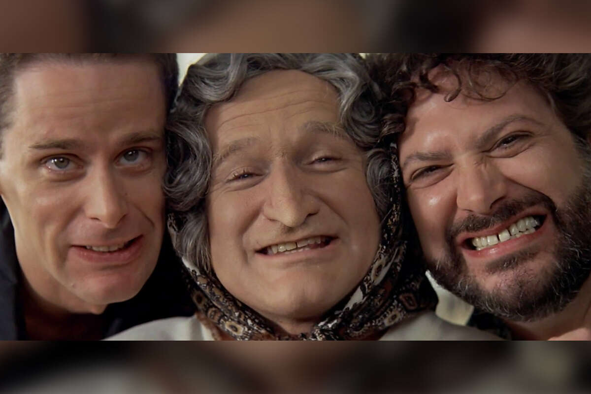 A still from the famous scene wherein Daniel Hillard becomes Mrs. Doubtfire features (L-R: Scott Capurro, Robin Williams, and Harvey Fierstein). Scroll ahead to see more stills from the scene.