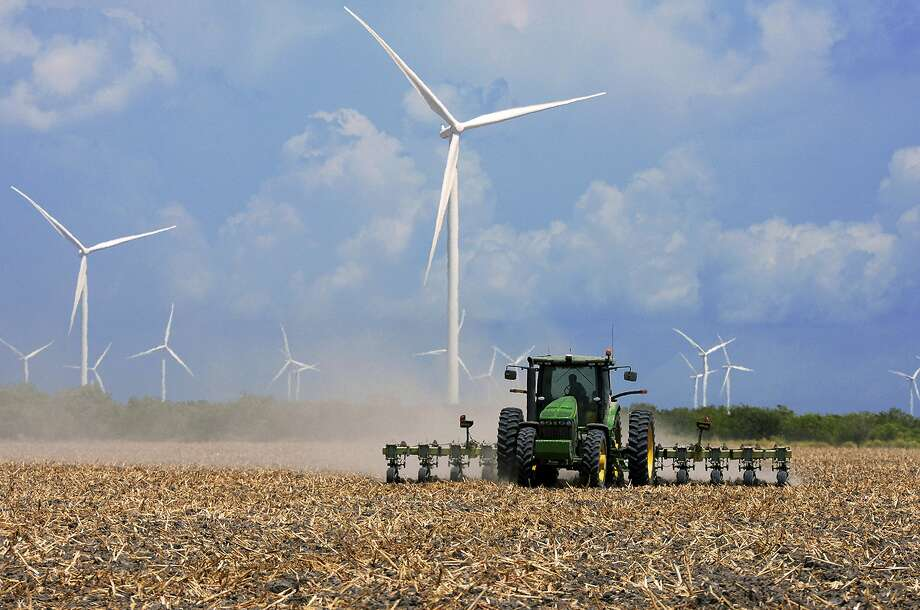 FILE - In this Aug. 17, 2015, file photo, a farmer plows his recently harvested field under wind turbines in the agricultural area north of Rio Hondo, Texas, near the New Mexico border.  Photo: Jason Hoekema, Associated Press