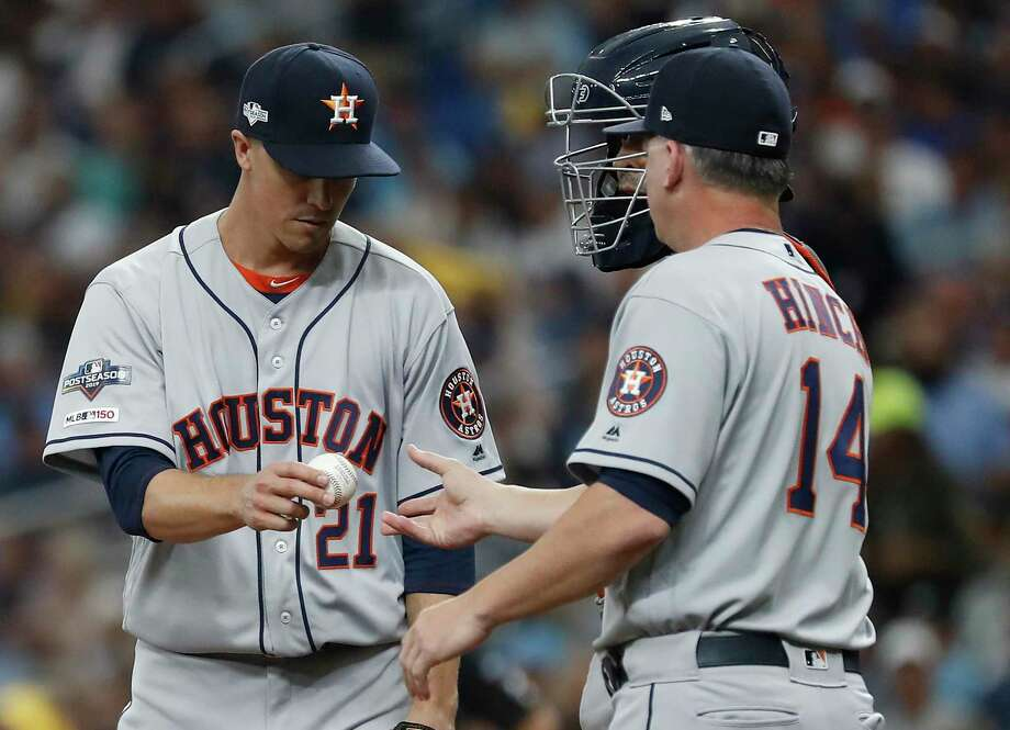 Astros pitcher Zack Greinke (21) hands the ball to manager A.J. Hinch after failing to get out of the fourth inning Monday in Game 3 of the American League Division Series. Greinke allowed six runs, including three homers, in the Astros' 10-3 loss to the Rays. Photo: Karen Warren, Houston Chronicle / Staff Photographer / © 2019 Houston Chronicle
