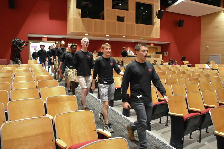 The Yale Whiffenpoofs walk into the Saxe Middle School Auditorium in New Canaan Sept. 25. Photo: Contributed Photo / New Canaan Public Schools / New Canaan Advertiser Contributed