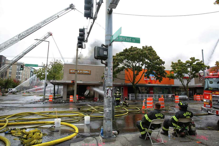 Firefighters work to extinguish a 3-alarm fire that broke out in the 2300 block of NW Market Street and destoryed several businesses, including Kitchen N' Things, La Isla Restaurant and Supercuts. Photo: GENNA MARTIN, SEATTLEPI.COM / SEATTLEPI.COM