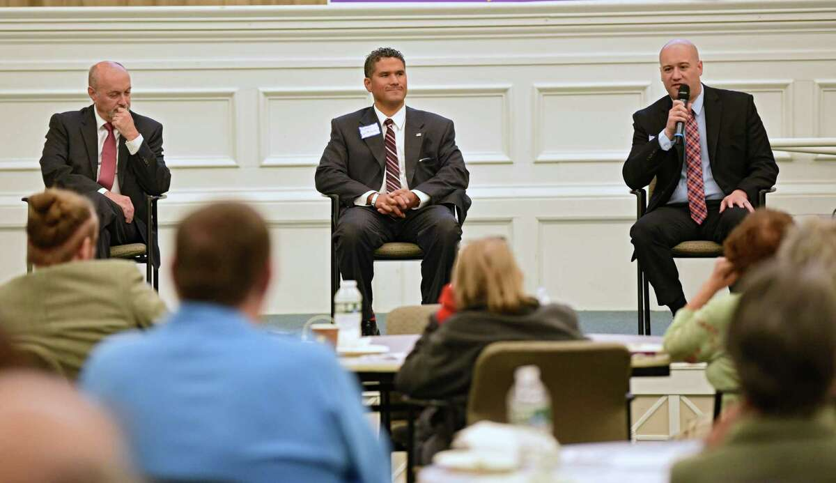 Troy Mayor Patrick Madden, left, faces former City Council President Rodney Wiltshire, center, and Republican challenger Thomas A. Reale in the city's second mayoral debate at Sage College on Monday, Oct. 7, 2019 in Troy, N.Y. (Lori Van Buren/Times Union)