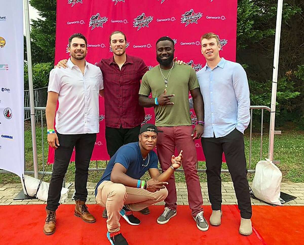 Giants minor-leaguer Tyler Cyr, left, poses with fellow Eastern League All-Stars (from left) Jonah Arenado, Jacob Heyward, Caleb Barager and Jalen Miller (kneeling) at an event before the July All-Star Game.