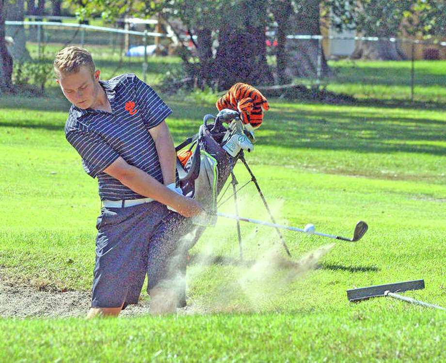 Edwardsville's Ian Bailey hits out of a sand trap on hole No. 13 at Arlington Greens Golf Club in Granite City during Monday's Class 3A Collinsville Regional. Photo: Scott Marion/The Intelligencer
