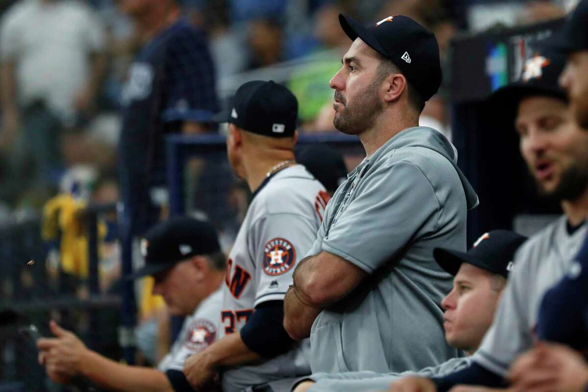 Houston Astros starting pitcher Justin Verlander stands in the dugout late in Game 3 of the American League Division Series against the Tampa Bay Rays at Tropicana Field on Monday, Oct. 7, 2019, in St. Petersburg, Fla.