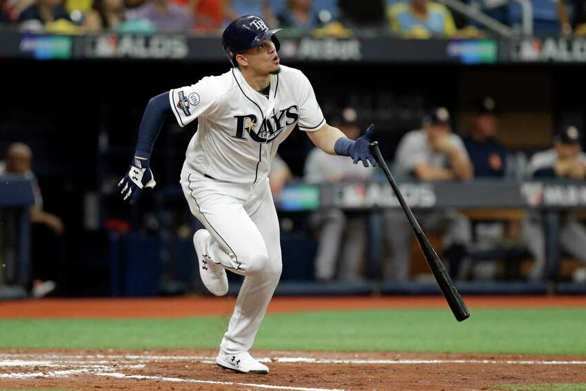 Tampa Bay Rays' Willy Adames hits a double against the Houston Astros during the second inning of Game 3 of a baseball American League Division Series, Monday, Oct. 7, 2019, in St. Petersburg, Fla. (AP Photo/Chris O'Meara)