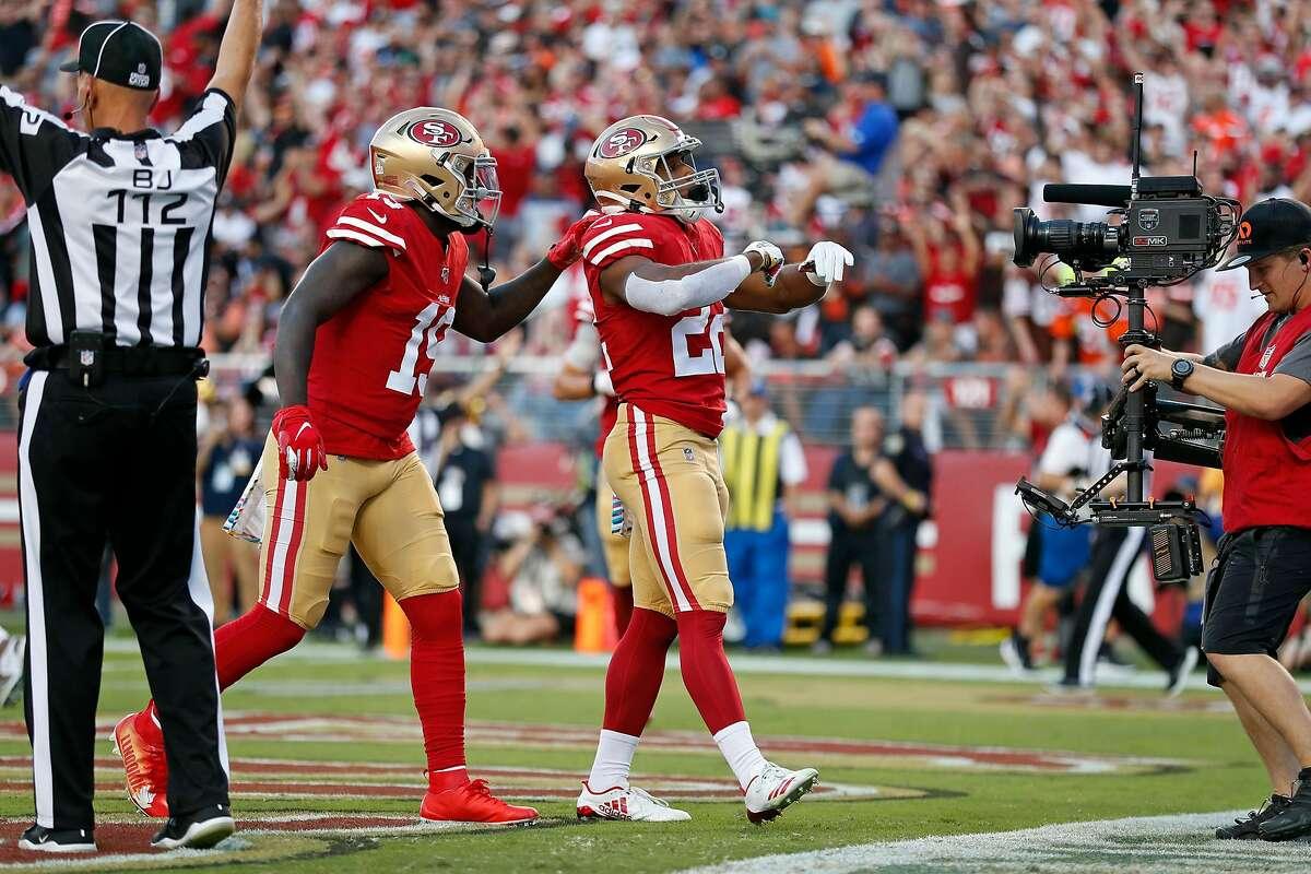 San Francisco 49ers' Matt Breida celebrates his 1st quarter touchdown reception with Deebo Samuel against Cleveland Browns during NFL game at Levi's Stadium in Santa Clara, Calif., on Monday, October 7, 2019.