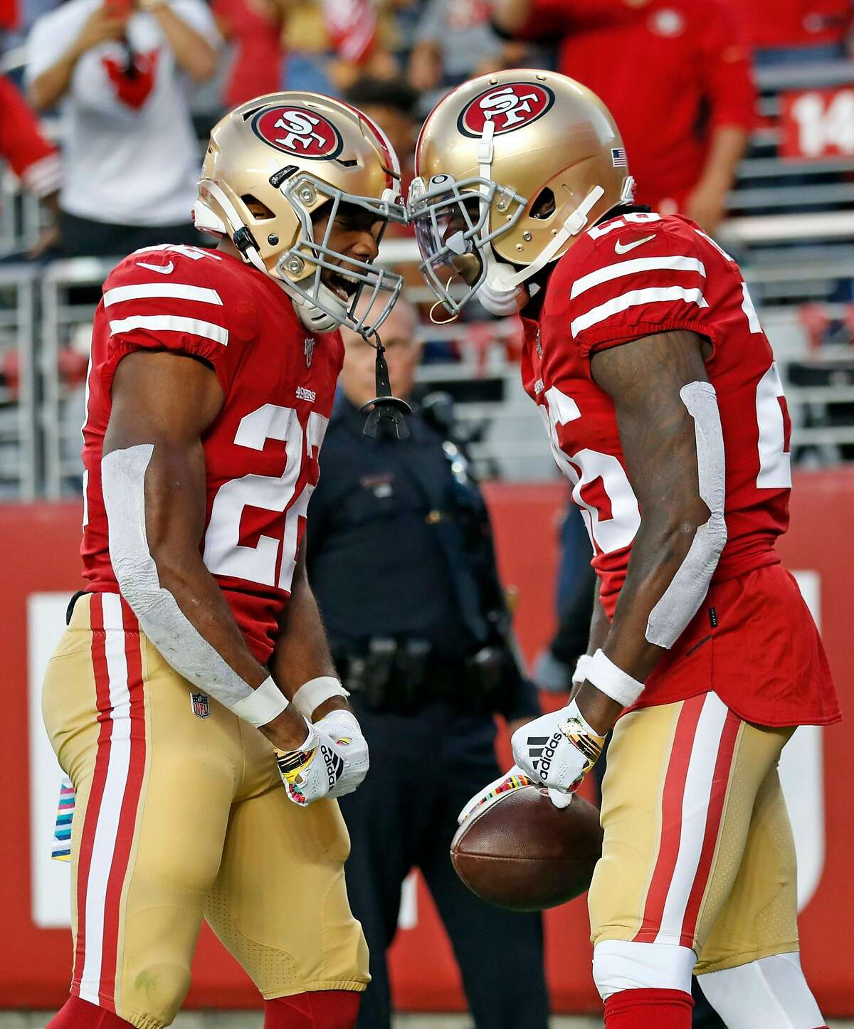 San Francisco 49ers' Matt Breida and Tevin Coleman celebrate Coleman's 2nd quarter touchdown run against Cleveland Browns during NFL game at Levi's Stadium in Santa Clara, Calif., on Monday, October 7, 2019.