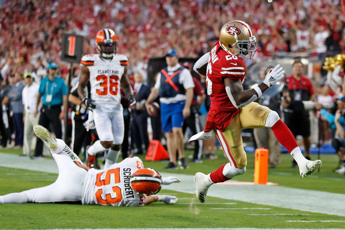 San Francisco 49ers' Tevin Coleman leaves Cleveland Browns' Joe Schobert in his wake during 2nd quarter touchdown run during NFL game at Levi's Stadium in Santa Clara, Calif., on Monday, October 7, 2019.