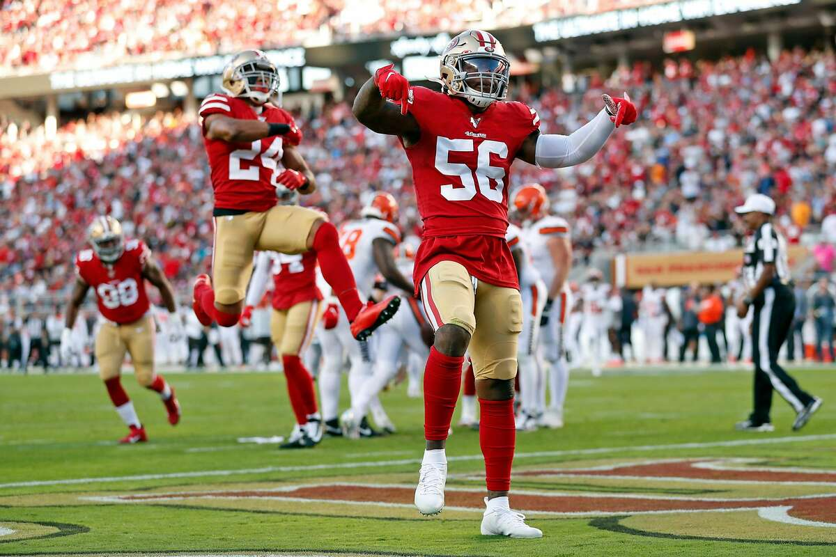 San Francisco 49ers' Kwon Alexander (56) and K'Waun Williams celebrate sack of Cleveland Browns' Baker Mayfield in 1st quarter during NFL game at Levi's Stadium in Santa Clara, Calif., on Monday, October 7, 2019.